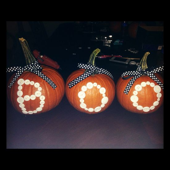 DIY for Halloween, with just buttons and a ribbon on each pumpkin