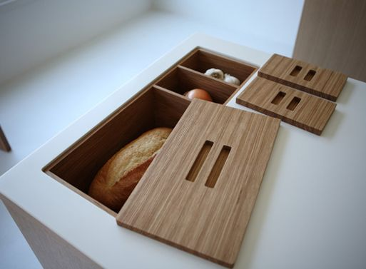 in-counter storage for bread, onions, potatoes, etc