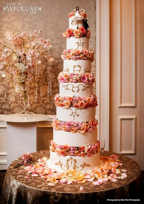 Towering orange & pink wedding cake
