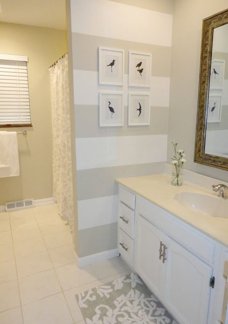 Our Guest Bathroom was painted in Behr Ocean Pearl, flat. The white stripe accent was Behr Sea Salt,