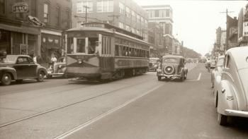 Wartime view of Newport News - A vintage streetcar dating to World War I transports passengers in downtown Newport News 25 years later during World War II.