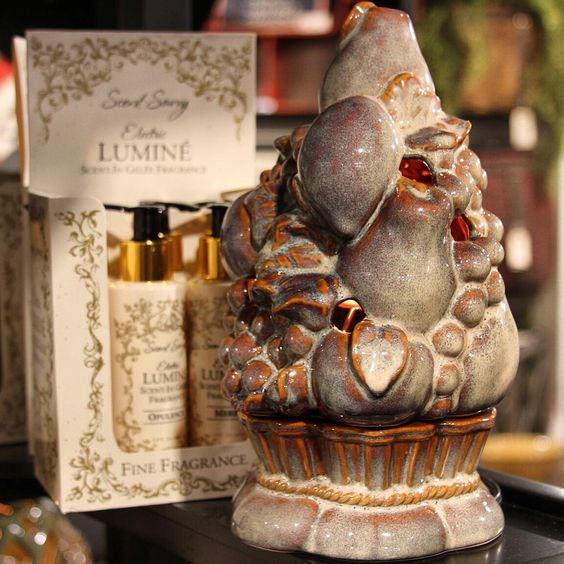 """The Electric Lumine Fragrancer has a Refillable Scentercore that """"warms"""" from within and will instantly fragrance when paired with Scent-In Gelee Fine Fragrance! Personalize it's golden flameless glow with fragrance to instantly enjoy Decor that Fragrances!"""