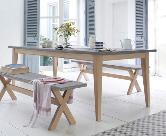 Our Conker kitchen table is an oak frame table with a lovely looking polished concrete top that is actually a tough resin that's wipeable, warm and...