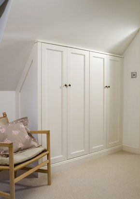 Wardrobe makes good use of the space under the eaves.
