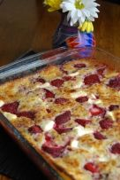 strawberry cream cheese cobbler  1/2 cup butter  1 egg, lightly beaten   1 cup milk  1 cup flour  1 cup sugar  2 tsp baking pwdr  1/2 tsp salt   2 quarts strawberries, washed & capped   4 oz. cream cheese, cut in small pieces    preheat oven to 350 f. melt butter & pour into a 9x13 baking dish. in a small bowl, mix egg, milk, flour, sugar, baking powder & salt. pour over the butter, but do not stir.  add the strawberries & cream cheese pieces. bake for 45 minutes, or until top is golden.