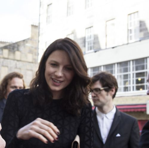 Caitriona Balfe shares an intimate moment with costar Sam