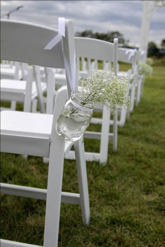 @Julie Taylor Mason jars w/ ribbon to hold you aisle flowers...obviously different flowers!