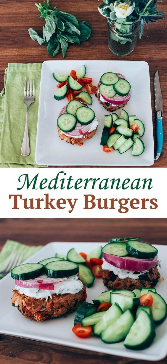 Mediterranean Turkey Burgers -- Topped with crunchy veggies and a tangy yogurt sauce, these high-protein turkey burger patties will fill you up on good stuff without weighing you down. // lunches // dinners // nutrition // healthy recipes // sun-dried tomatoes // feta cheese // beachbody blog:
