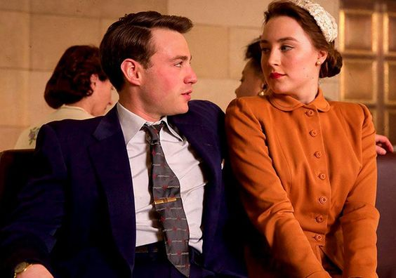 Emory Cohen and Saoirse Ronan in Brooklyn (2015).: