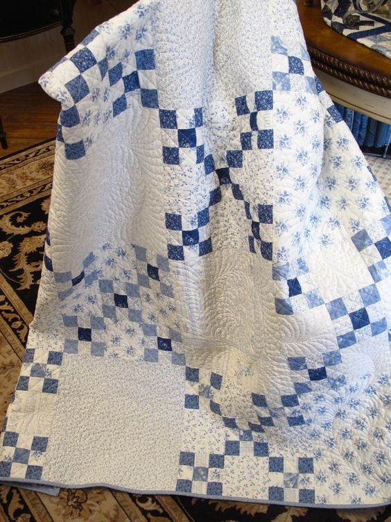 not link to the quilt pictured - the link is to instructions to make this style of quilt (double nine patch). I LOVE the low volume background!