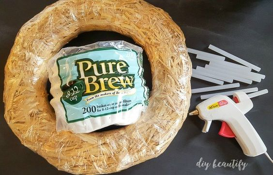 Did you know that you can turn a plain straw wreath and a bag of coffee filters into an amazing Winter White Wreath...for about $5?! What a great holiday gift i…