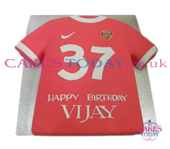 "Arsenal #T-Shirtcake by Cakes Today ideal for the true Arsenal ""Gooner"" Fan.#Cake with three layers of our traditional light vanilla sponge recipe covered and hand-decorated with an age related number, the cake is finished with a message to your personal specification.  Please note that all photos are representative, all our cakes are handmade and therefore decorations and finish will vary.  This Cake Includes:  - Iced Cake Covering - Football Jersey Shape - Unique Arsenal FC Theme"