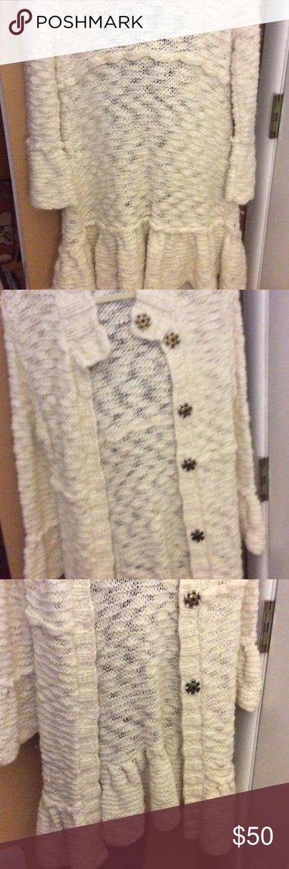 Free people sweater coat Beautiful Freepeople long sweater coat !!! Not meant for super cold weather . Perfect condition size large . Would be cute with jeans and boots or dressed up !! Free People Jackets & Coats
