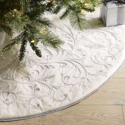 Our sweet, snowy tree skirt features sparkly, embroidered scrolls on a bright white backdrop, wrapping your tree with the magic of a glistening white Christmas. It makes the perfect place to put your expertly wrapped presents.