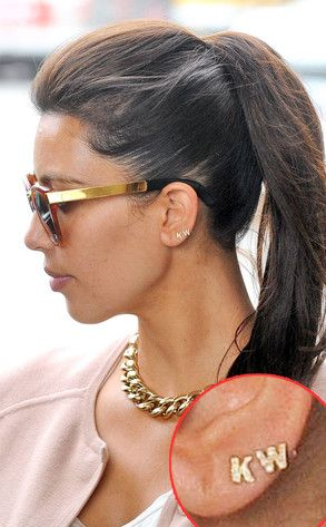 Kim & Kanye put an earring on it!  Not a fan of this!