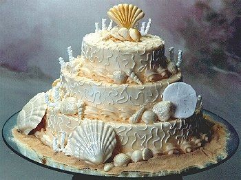 This is one of the cake designs I like--except with four layers and more color on the coral