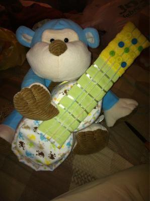Guitar and animal diaper cake
