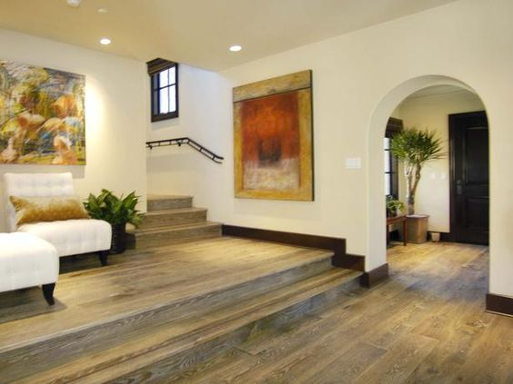 Multi-Level Entryway: This entry hall tapers up to an informal lounge resting on a two-step riser. From HGTVRemodels.com