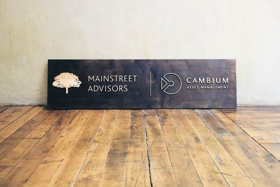 Mainstreet Advisors Torched Wood Sign
