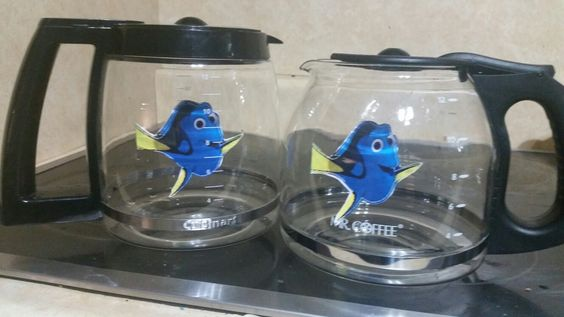 Finding Nemo Party Decor Centerpiece - super cute,  easy and cheap. Just printed an image from Google images and hung from fishing line inside a coffee carafe.