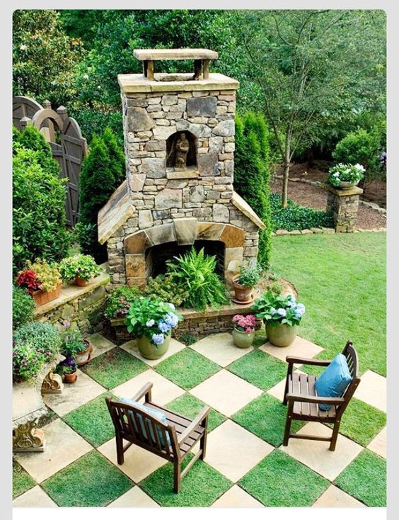 Chessboard garden idea with artificial tuf. This is gaining popularity in other areas of the world - no mowing, no bugs, no watering...