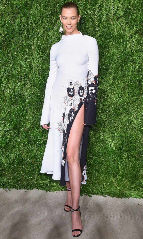 Karlie Kloss in a high-slit, high-neck long-sleeve Prabal Gurung dress