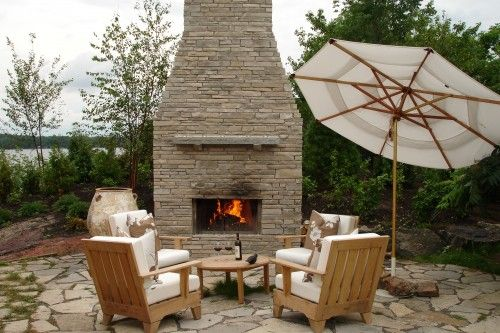 outdoor fireplace with pieced rock and moss