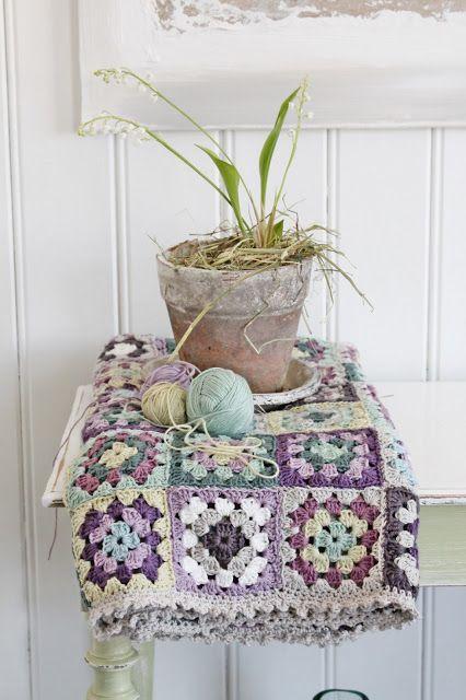A crocheted blanket in lovely muted pastel colors. http://vibekedesign.blogspot.com.es/2013/04/grannyteppe-av-vibeke-design.html