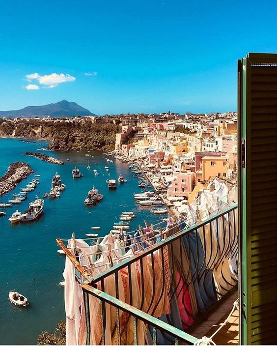 What a view! That's from Procida Island right in front of NaplesThanks @ valerio.diana more of Italy's culinary curiosities? Join Nonna Box and explore a different Italian region. Link in bio!