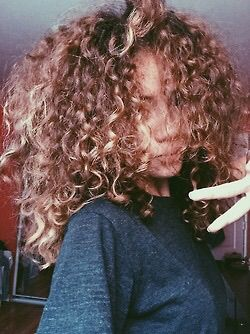 Letting curls be curls. Caramel colored tumbling locks.