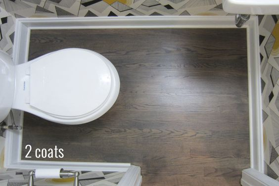 The powder room with 2 coats of stain on the floors