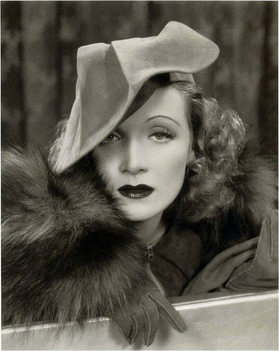 Marlene Dietrich, wearing a hat by Travis Banton (ca. 1935). Banton produced his best work for Dietrich.: