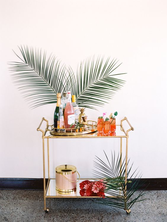 "With a vision of ""a glamorous garden party with the nostalgia of Palm Springs,"" this all-star team of creatives dreamt up this tropical bridal shower editorial we want to dive right into. Palm leaves and pineapples, bright colors and signature cocktails — this shoot"