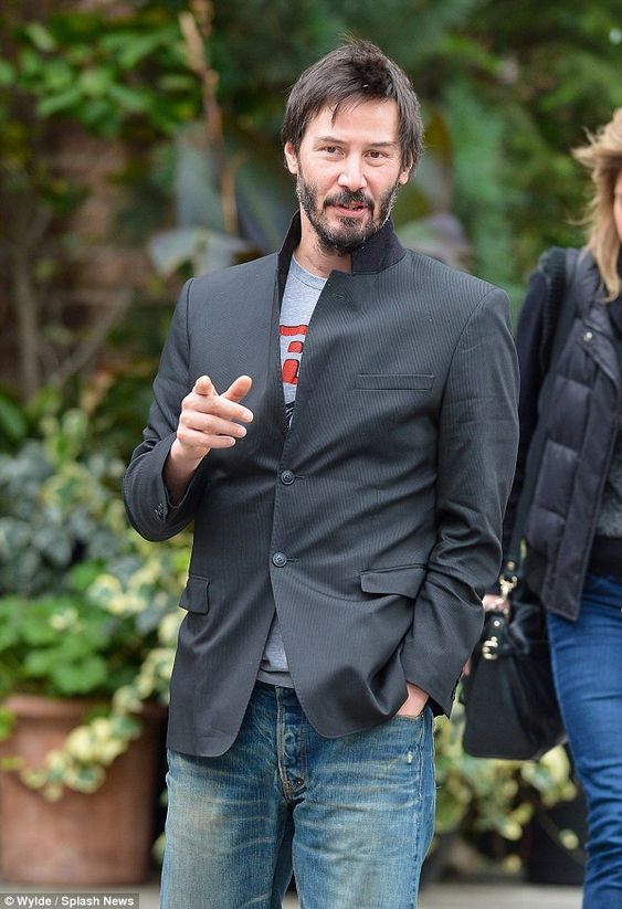 Casual stroll: Keanu Reeves was dressed down for his walk through New York City on Sunday...