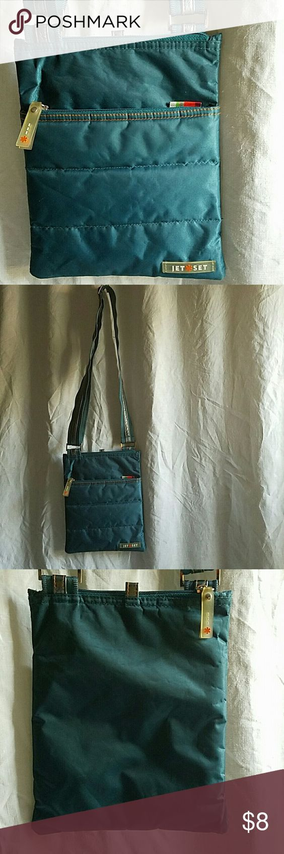 Crossbody Bag in Aqua This lightweight crossbody Bag is perfect to use while traveling.   ??Bundle and save ??Offers welcome thru the '?ffer' button  ??Fast Shipping  ??No trading JetSet Bags Crossbody Bags