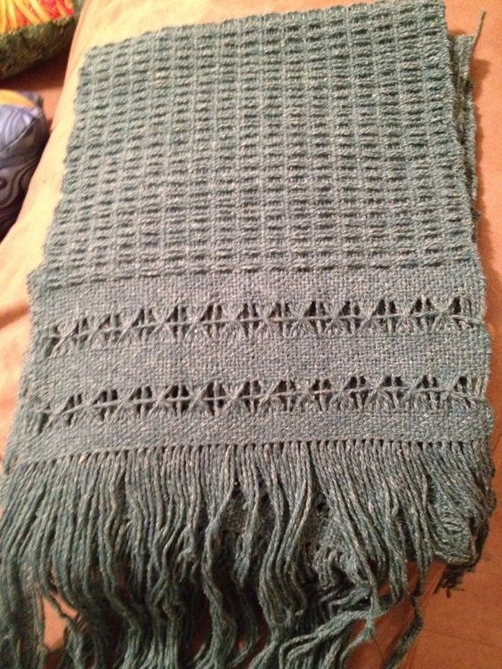 My first attempt at using a pick up stick pattern and doing Brookes Bouquet. Wool/silk blend yarn on a 20inch Ashford rigid heddle loom. The color in this pic is off. Its really a dusty teal.
