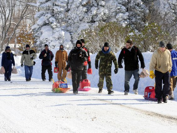 "This picture is from USAToday. The caption was ""neighbors in Buffalo venture out into the snow for gas and supplies."" Note the 12 pack of Bud light LOL"