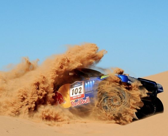 Race truck kicking up some sand