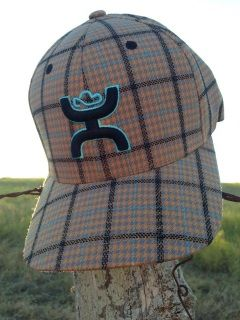 HOOey Catalina Flexfit Orange Plaid with HOOey Black Hands Up Logo Outlined in Light Blue. HOOey scoreline logo embroidered in light blue on the back of the hat.  Flexfit fitted style. Elastic band. Sizes available: S/M and L/XL
