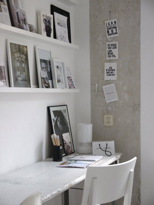 white shelving + picture/art, prints hanging on a wire