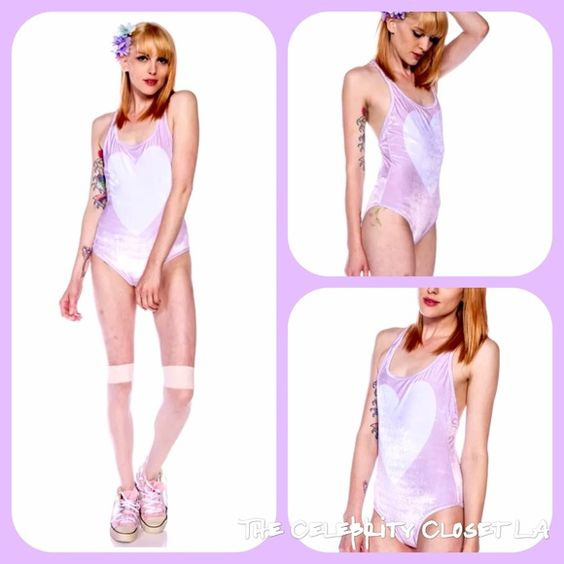 Wildfox Rare!! NWT Romeo white heart one piece Soft and cute! This sexy one piece is great plain or w a slouch sweater or cardigan all available here! On sale! This is completely sold out, last one available!! Discounts available! Wildfox Tops