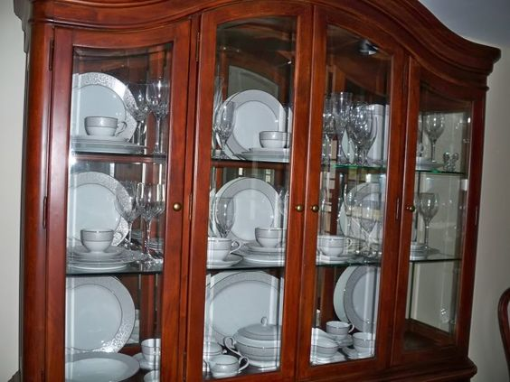 China display and china display on pinterest for Arranging dishes in kitchen cabinets