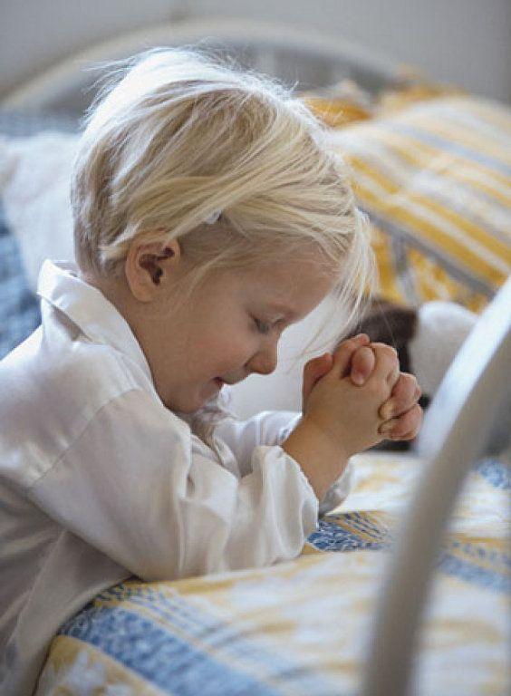 Beautiful blonde child in white shirt, kneeling in prayer at bed. #prayer #child #Christianity #faith