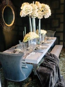 """""""This tablescape creates an intimate feeling, regardless of the size of your party,"""" says Dolce Designs Studio event specialists Christina Whittle and Zaid Arriola, who used our Organic vases and Village flowers for the centerpiece. Photo by Jessica Claire Photography."""