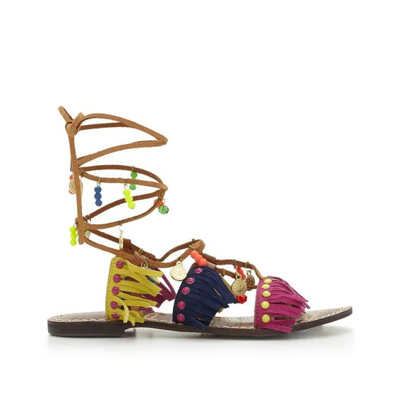 Meet the Liora sandal: a lace-up suede fringe gladiator that