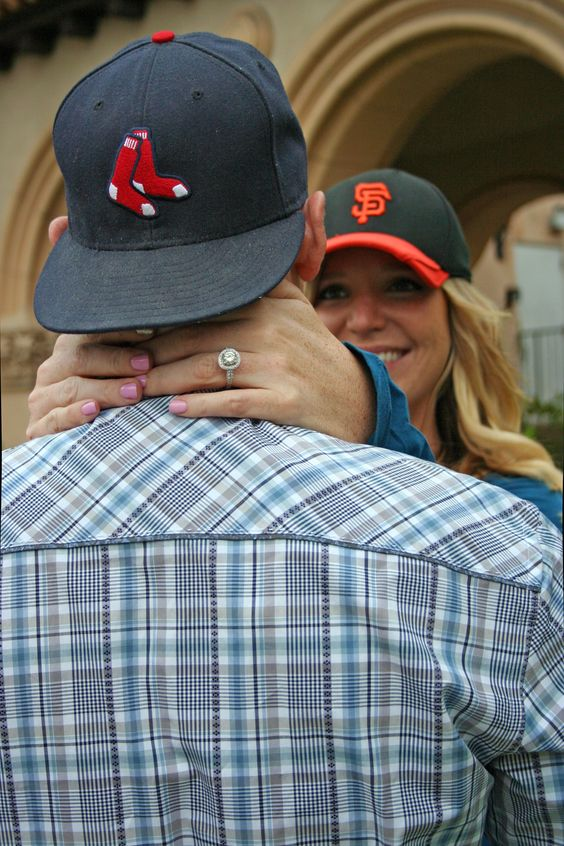 Engagement photo shoot. Showing off the ring. Sports-themed engagement. Favorite teams. Engagement pictures