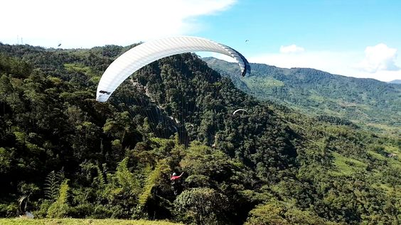 Paragliding over giant waterfalls - Image 4