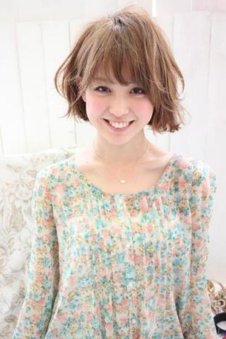 明るい髪色をした宮司愛海