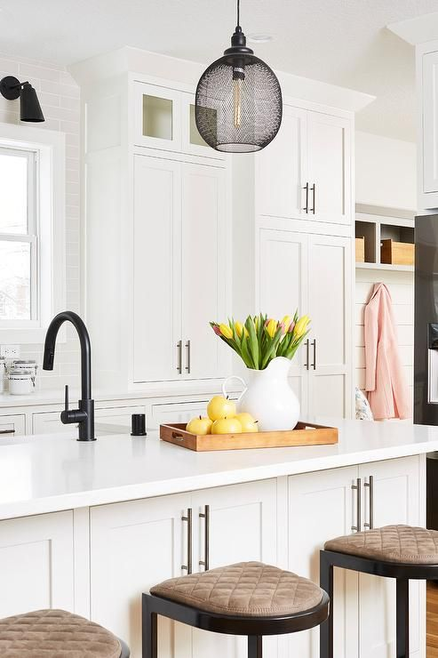 An Oil Rubbed Bronze Faucet Paired With A Farm Sink Is Fitted To A