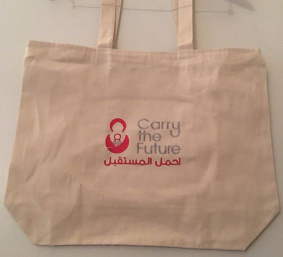 Carry The Future Tote Bags and Cardigans.  Tote Bags Measure approximately 20 wide x 15 tall. They are zippered and Made of Canvas.
